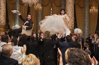 bride-in-vera-wang-ball-gown-groom-in-tuxedo-bride-and-groom-lifted-during-chair-in-hora