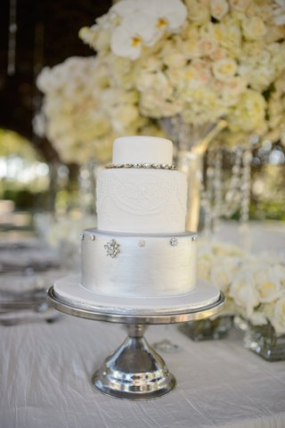 three-layer-cake-with-silver-bottom-tier-and-white-top-layers
