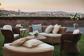 couches-and-chairs-on-lawn-overlooking-view-of-rome