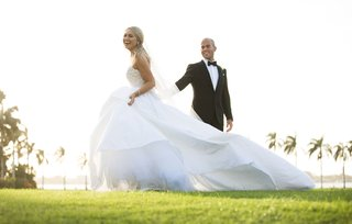 bride-in-strapless-ball-gown-with-long-train-with-groom-in-tuxedo-palm-beach-florida