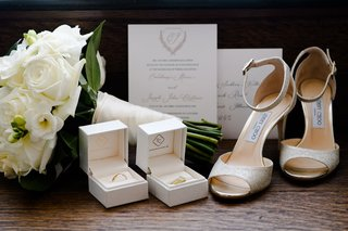 jimmy-choo-wedding-shoes-glitter-with-wedding-rings-invitation-and-white-rose-bouquet