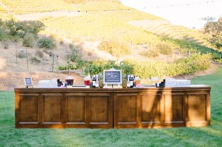 outdoor-wooden-bar-vineyard-rustic-chic-wedding-professional-event-california-cocktails-lawn-farm