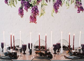 wedding-reception-event-inspiration-tablescape-ghost-chairs-tall-taper-candles-purple-white-goblets