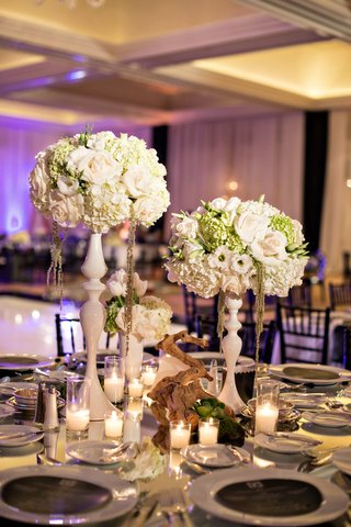 modern-and-magical-centerpieces-decorative-vases-tree-branch-centerpiece-candles-purple-lighting