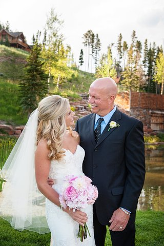 big-sky-montana-wedding-location-father-of-bride-looks-at-daughter