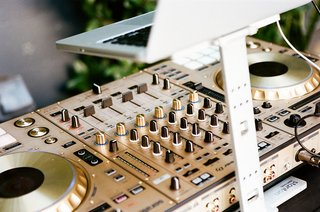 wedding-reception-outdoor-dj-entertainment-dj-controller-music-spinner