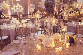 opulent-wedding-decor-centerpieces-with-glass-orbs-holding-tea-lights