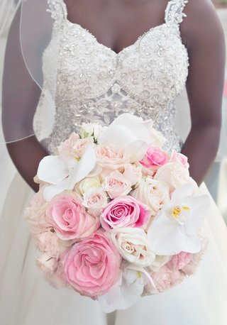 bride-in-jewel-bodice-wedding-dress-holding-pink-rose-white-orchid-bridal-bouquet