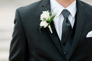 groom-boutonniere-with-two-white-roses-greenery-accents