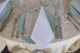 place-setting-patterned-charger-champagne-hued-linens-new-york-city-bridal-shower-decor-floral