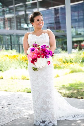 a-bride-in-fitted-lace-gown-with-bright-bold-bouquet-pink-purple-white-flowers