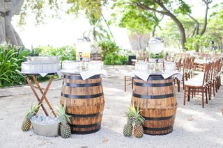 barrels-with-infused-water-station-and-pineapples-as-decor-for-hawaiian-wedding