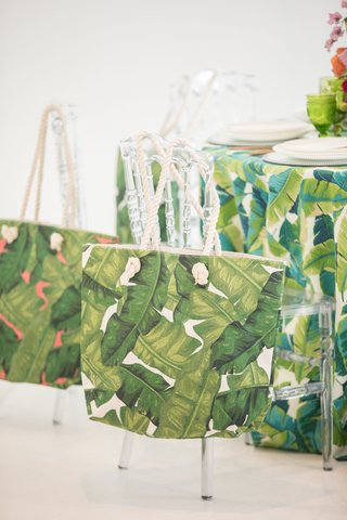 tropical-wedding-inspiration-banana-leaf-print-tote-bags-acrylic-chiavari-chairs