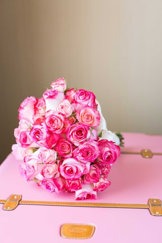 hot-pink-and-light-pink-rose-bouquet-double-delight-roses-on-baby-pink-camel-leather-suitcase
