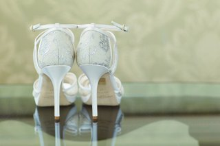 white-jimmy-choo-wedding-shoes-with-ankle-strap-and-lace
