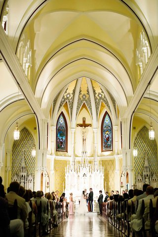 bride-and-groom-at-altar-of-immaculate-heart-of-mary-chapel-in-ohio