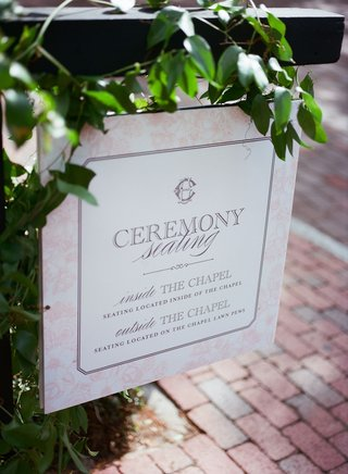 wedding-ceremony-sign-directing-guests-inside-chapel-and-on-the-lawn-to-witness-the-ceremony