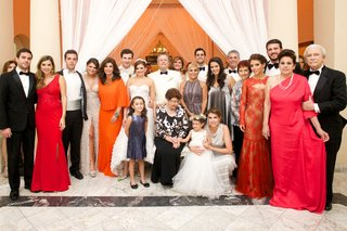 francesca-miranda-daughter-daniella-jassir-wedding-guests-attendees-friend-family-red-orange-gowns