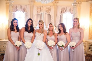 bride-in-strapless-reem-acra-wedding-dress-with-bridesmaids-in-champagne-pink-bridesmaid-dresses