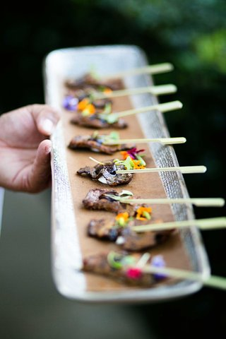 wedding-cocktail-hour-appetizer-beef-on-toothpick-skewer-with-edible-flower