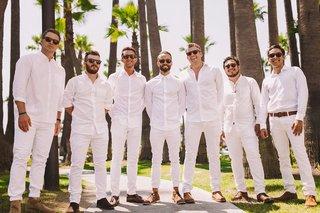 groom-and-groomsmen-in-all-white-white-dress-shirt-and-white-linen-pants