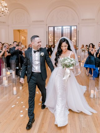 wedding-recessional-at-los-angeles-ballroom-bride-in-overskirt-candles-flower-petals