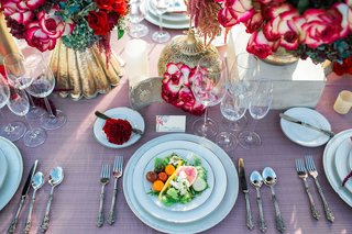 fresh-salad-pink-table-linen-white-china-gold-vases-red-and-purple-floral-arrangements-rustic