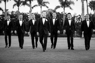 black-and-white-photo-of-wedding-party-groomsmen-tuxedo-bow-tie-palm-beach-palm-trees