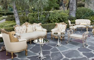 treelike-coffee-tables-and-gold-upholstered-chairs