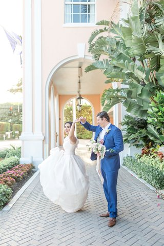 the-confused-millennial-wedding-shoot-bride-and-groom-dancing-at-venue-outside-pink-hotel-palm-trees