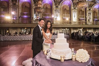 bride-in-vera-wang-dress-and-groom-cut-into-cake-at-hilton-chicago-wedding-reception