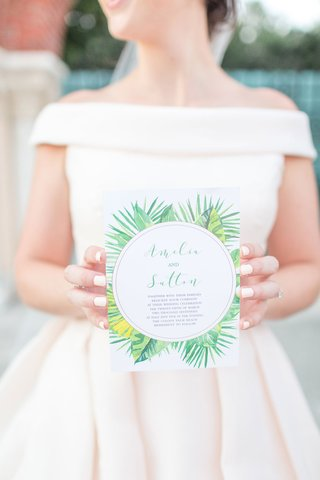 the-confused-millenial-wedding-shoot-invitation-green-palm-print-white-manicure-off-shoulder-gown