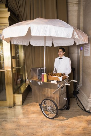 silver-cart-with-white-umbrella-for-wedding-guests-pretzels