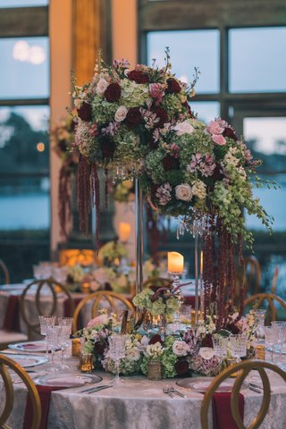 textured-linens-rock-crystal-stands-cascading-orchids-burgundy-amaranthus-gold-and-silver-stands