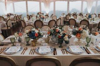 wedding-reception-french-round-back-chair-low-centerpiece-blue-hydrangea-orange-rose-anemone-menu