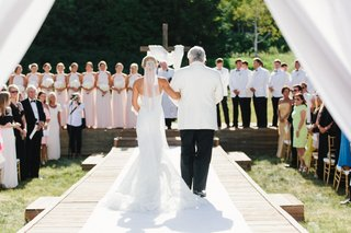 wedding-ceremony-father-of-bride-walking-her-down-aisle-white-aisle-runner-outdoor-ceremony-cross