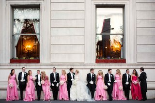 bride-and-groom-outside-hotel-with-pink-bridesmaids