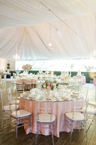 calamigos-ranch-tented-wedding-reception-clear-chiavari-chairs-blush-and-ivory-centerpieces