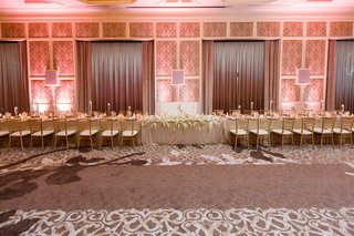 sweetheart-table-with-tufted-white-seating-in-between-two-long-kings-tables-gold-chiavari-chairs