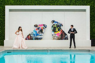 bride-in-le-spose-di-gio-blush-gown-groom-in-black-suit-london-west-hollywood-rooftop-pool