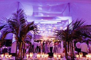 beach-wedding-reception-dance-floor-purple-lights-candles-palm-trees-tent-wedding-venue