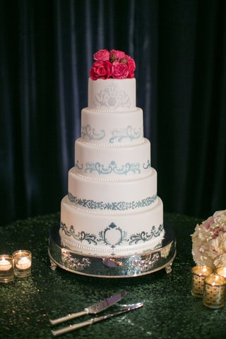 white-cake-with-moroccan-handpainted-design-and-pink-flower-topper