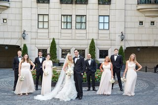 bride-in-vera-wang-gown-groom-in-tuxedo-with-bridal-party-bridesmaids-in-cream-bridesmaid-dresses