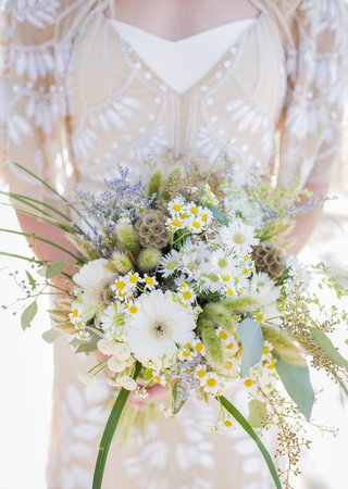brides-wildflower-bouquet-different-flowers-blooms-daisies-green-leaves-lilacs-olive-leaves