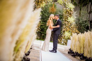 pampas-grass-along-aisle-art-deco-inspired-wedding-elaborate-chuppah