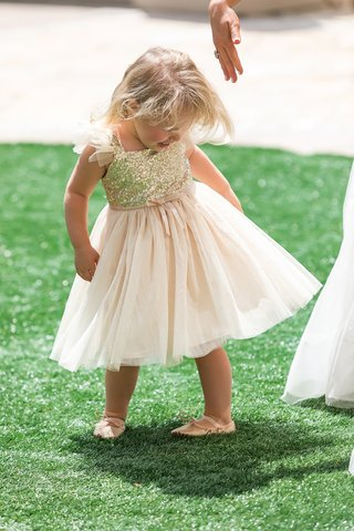 adorable-flower-girl-in-dress-with-gold-sequin-top-and-soft-blush-skirt