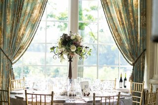 wedding-table-in-front-of-window-with-vintage-curtains