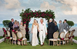 wedding-ceremony-small-guest-list-acqualina-resort-and-spa-green-arch-pink-roses-wood-chairs-round