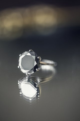 brides-engagement-ring-with-a-round-black-diamond