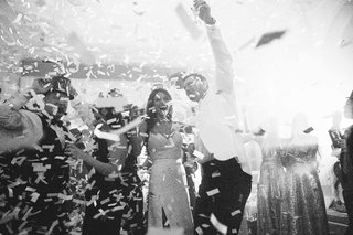 black-and-white-photo-of-confetti-exploding-at-new-years-eve-wedding-reception-in-atlanta